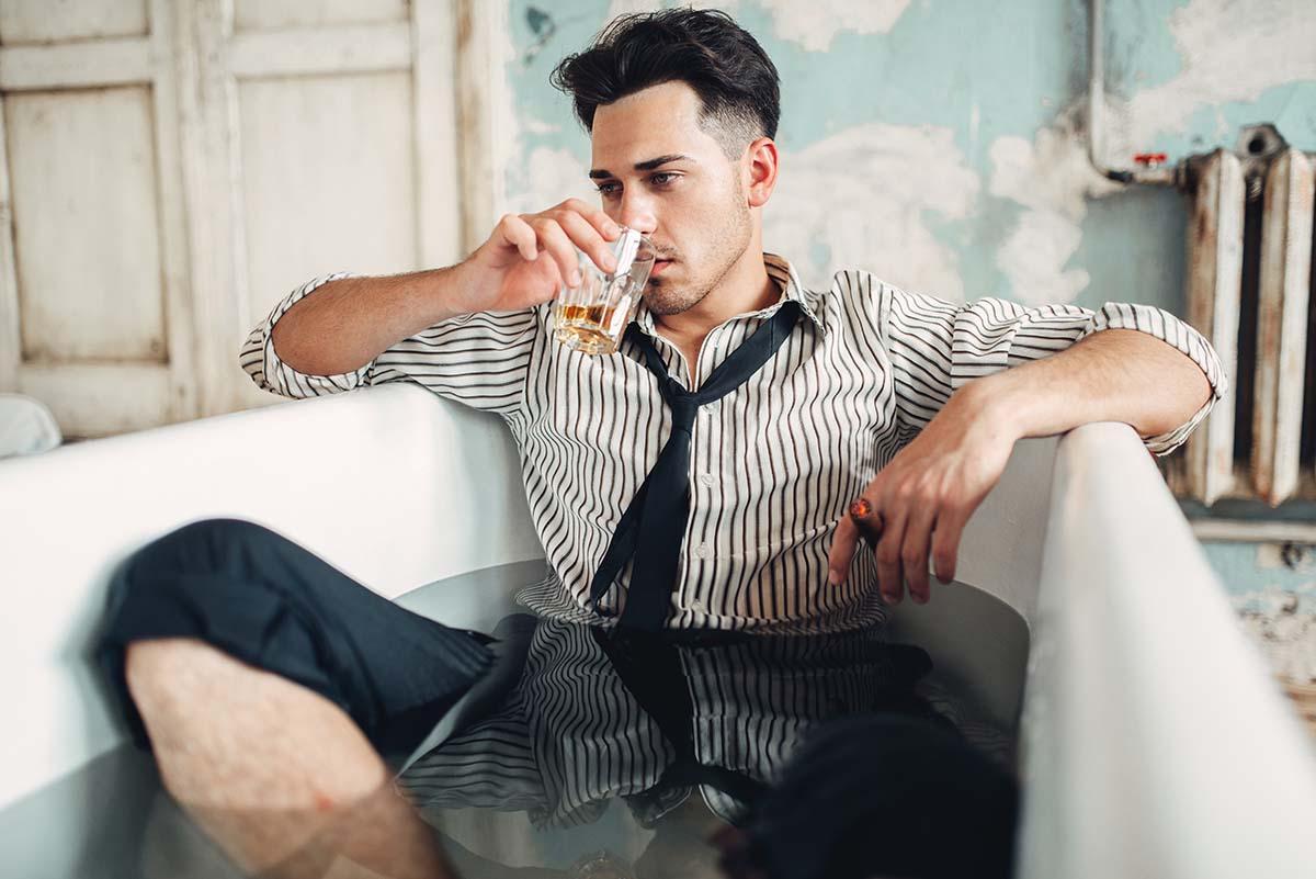 drunk-businessman-in-bathtub-suicide-man-concept-XTQUZNE.jpg